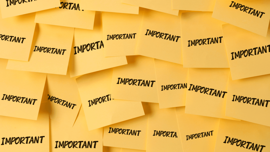 A bunch of sticky notes pasted on top of each other with the word 'Important' written on it